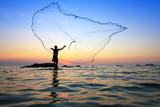 Fototapety throwing fishing net during sunrise, Thailand