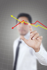 Businessman pushing graph for trade stock market.