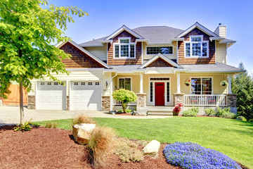 Large American beautiful house with red door.