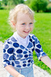 Smiling little girl in the park.