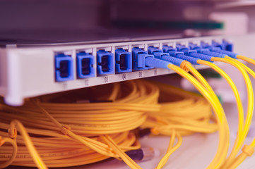 Panel of Fiber network switch with some yellow network cables