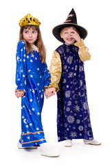 boy dressed as astrologer and a girl dressed as stars