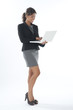 Happy female young business executive holding laptop.