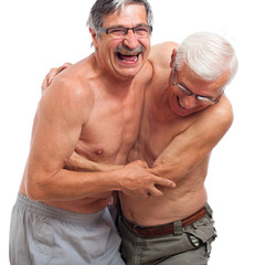 Laughing seniors fighting for fun