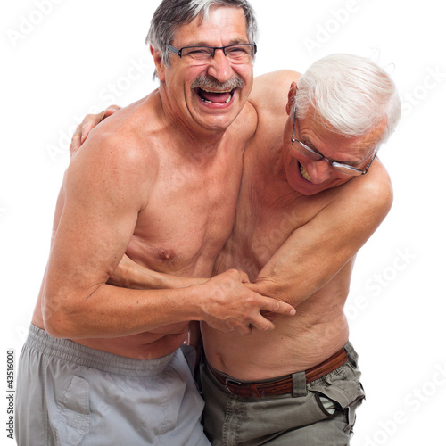 Laughing seniors fighting for fun