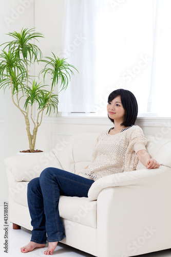 a young asian woman relaxing