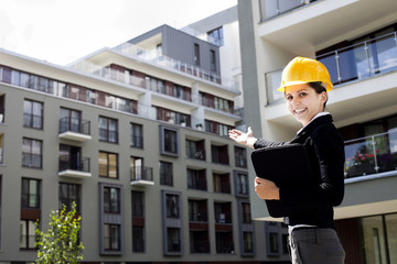 Female construction engineer show building