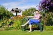 canvas print picture - Erholung im Garten auf der Bank