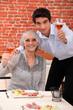 Grandchildren and grandparents toasting with wine