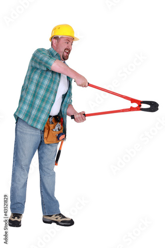 Aggressive man using bolt-cutters