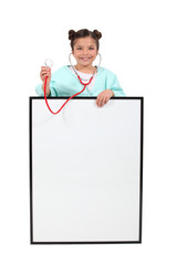 little girl dressed as nurse posing with copyspace