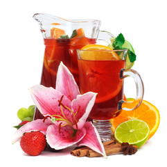 Refreshment beverage in pitcher and glass with fruits and spice