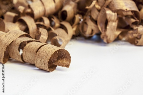 wooden shaving on pine wood background