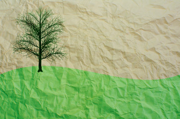 tree on recycled paper