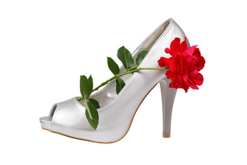 Silver women's heel shoe with red rose with clipping path.