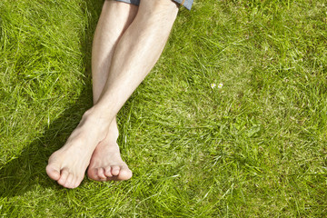 Young Adult sunbathing on grass