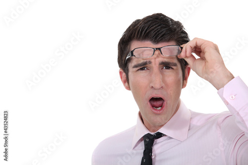 Man taking his glasses off in dismay