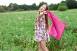 Woman with scarf on meadow