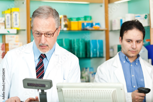 Two pharmacists in their store