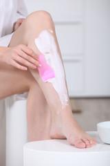 Women shaving her legs
