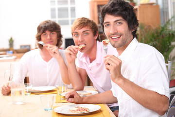 Three friends enjoying outdoor meal together