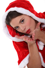 Female Santa Claus blowing kiss