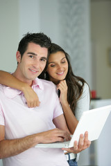 Couple stood with laptop