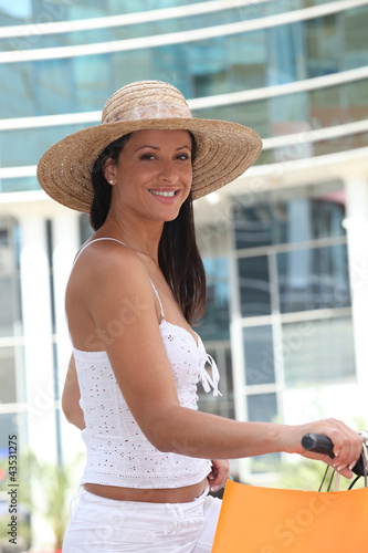 Woman in a straw hat doing a spot of shopping