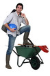Tradesman with his foot propped up on a wheelbarrow