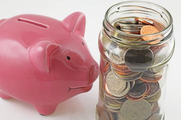 saving jar with uk coins v piggy bank