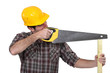A carpenter with a handsaw.