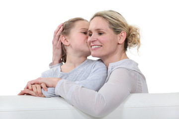Mother and daughter sat on sofa
