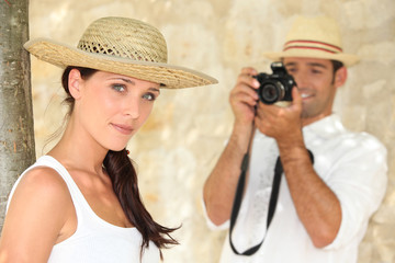 Man taking photograph of girlfriend