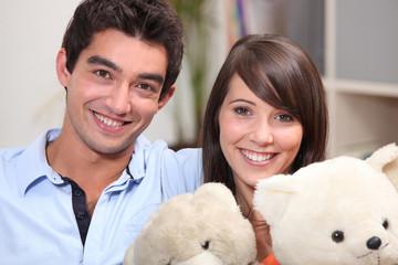 couple of teenagers with teddy bears