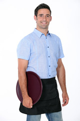 Portrait of a waiter with his tray