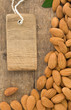nuts almond fruit and tag  label on wood