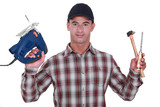 Man holding band-saw, hammer and chisel