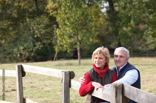 Couple by a paddock
