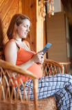 pregnant woman reads e-book