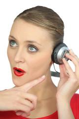 Surprised woman wearing headphones