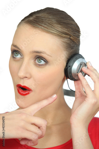 Surprised woman wearing headphones