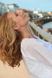 Blond woman posing by port