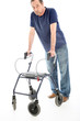 Despondent man leaning on medical walker