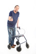 patient using a medical walker giving a thumbs up