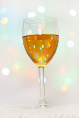 Glass of White Wine with Lights Background