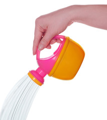 watering can with water on white