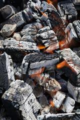 Flaming wood charcoal