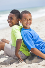 Young African American Boys Sitting Playing on Beach