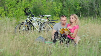 Attractive couple holding books