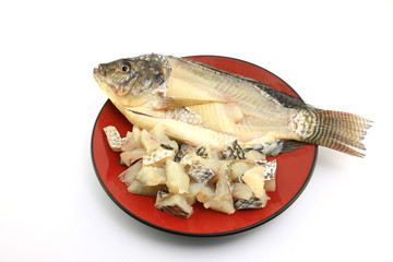Tilapia fillet, fresh water fish, on dish